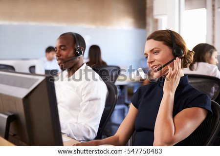 View Of Staff In Busy Customer Service Department