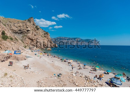 View of the Crimea beach and cape Aya with tourists