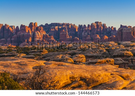View of the Magnificent Sunset over Needles District taken from the Pothole Point