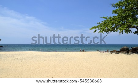 View of the sandy shore of the ocean. Bay with clear blue water.