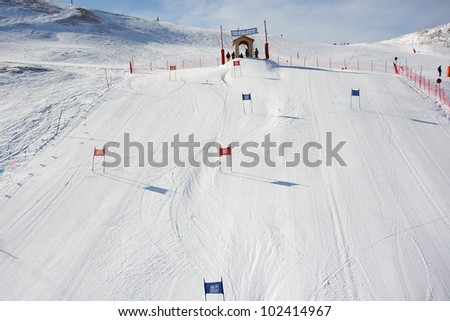 View of the ski slopes on winter sunny day on resort