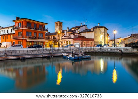 View of the small fishing village of Marano Lagunare at sunset. Province of Udine, Friuli Venezia Giulia, Italy