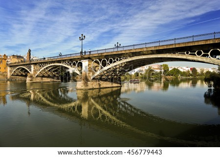View of the Triana Bridge (official name is Bridge of Isabel II) over the Guadalquivir River in Seville, Spain