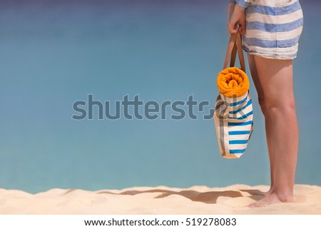 view of woman's legs at perfect caribbean beach, vacation concept with copyspace