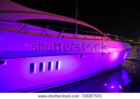 View of Yacht with pink and blue party lighting in South Beach