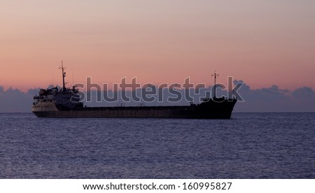 view on cargo ship at sunrise