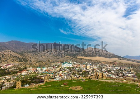 View on small town on mountains valley