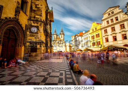View on the astronomical clock and cathedral on the old town square in Prague city. Long exposure image technic with blurred people and clouds