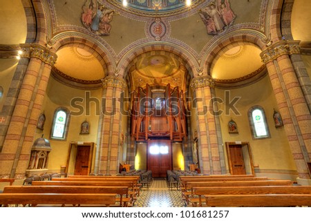 View pews and pipe organ inside Madonna Moretta catholic church in Alba, Northern Italy.