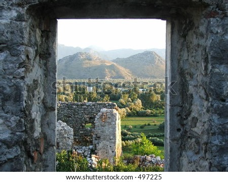 View through a window of a ruined medieval fortress of Zabljak, Montenegro