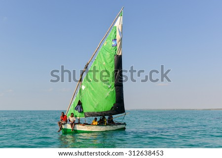 Vilankulos, Mozambique - July 6, 2012: Boys in a sailboat off of Magaruque Island, formerly Ilha Santa Isabel, is part of the Bazaruto Archipelago, off the coast of Mozambique.