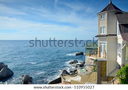 "Villa with sea view on a Sunny day. The inscription on the stone means ""I love you"" in Russian."