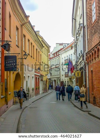 VILNIUS, LITHUANIA - MAY 2, - Narrow street with orange buildings in Vilnius on May 2, 2016