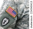 VILNIUS, LITHUANIA - MAY 17, 2014: US flag patch on the sleeve of army uniform. US army soldier was photographed during Public and Military Day Festival on May 17, 2014 in Vilnius, Lithuania.  - stock photo
