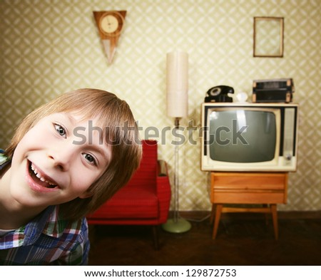 vintage art portrait of liitle boy looking out at camera in room with interior from 70s, retro stylization, toned