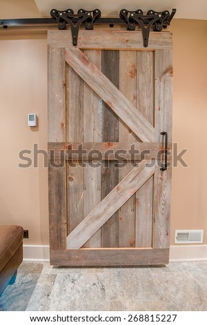 Vintage barn door on sensitive and precise rails
