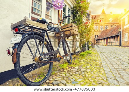 Vintage Bicycle On House Wall At Sunset, Old Town Street, Ribe, Denmark