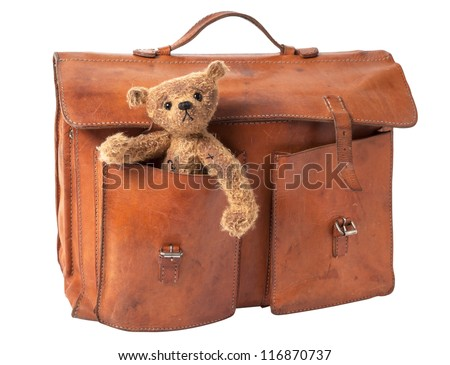 Vintage Briefcase with cute Teddy Bear. isolated on white background