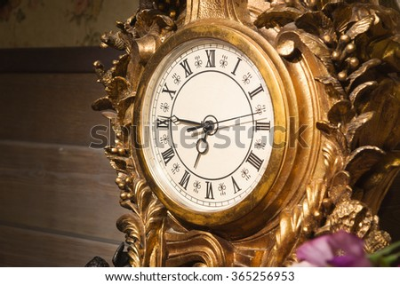 Vintage clock. Luxurious interior in the vintage style