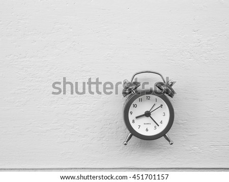 Vintage clock  on wooden background, Concept time to wake up