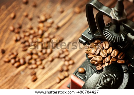 Vintage coffee grinder and coffee beans with space for text
