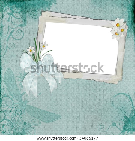 Vintage frame with daisies and bow on textured blue background