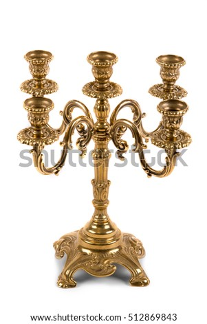Vintage golden candlestick on white background