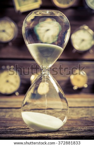 Vintage hourglass as the old way of timing