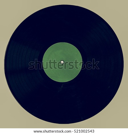 Vintage looking A vinyl record (music recording support) isolated on white