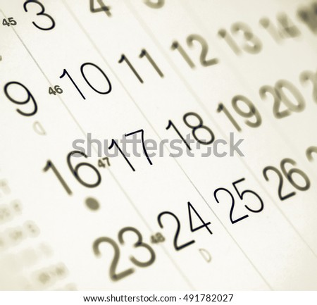 Vintage looking Detail of a calendar page with selective focus