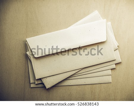 Vintage looking Letter envelopes for mail postage on wooden table
