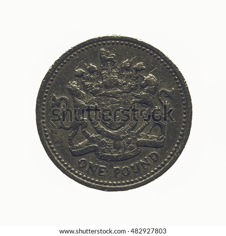 Vintage looking One Pound coin isolated over a white background