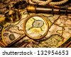 Vintage magnifying glass, compass, telescope lies on the ancient map of the North Pole (also Hyperborea). Arctic continent on the Gerardus Mercator map of 1595. - stock photo