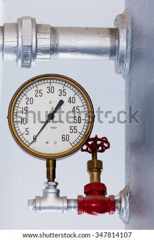 Vintage metal boiler tank with steampunk metal pressure gauge with scale in pounds lbs per square inch up to 60