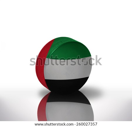 vintage old hockey puck with the united arab emirates flag