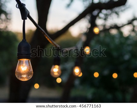Decorative outdoor string lights hanging on stock photo 436971544 vintage outdoor string lights aloadofball Image collections