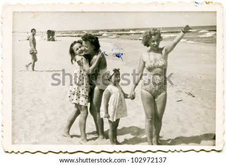 Vintage photo of family on beach (fifties)