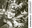 Vintage photo of father with little daughter, fifties - stock photo