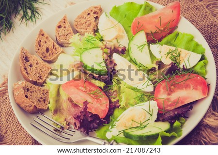 vintage photo of fresh salad with egg and vegetables