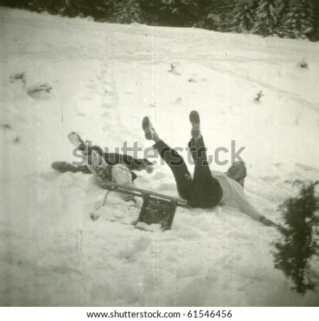 Vintage photo of mother and son during sledding (fifties)