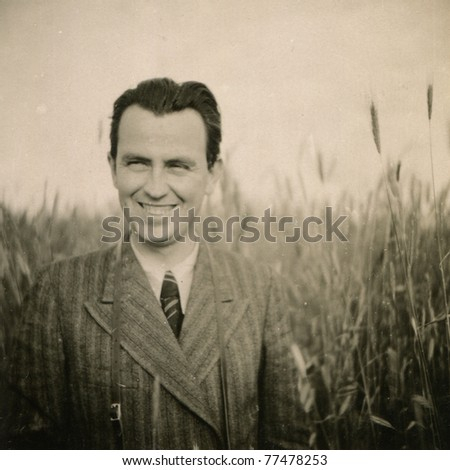 Vintage photo of smiling man (forties)