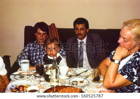 Vintage photo (scanned reversal film) - family dinner, early eighties