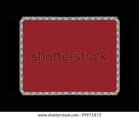 Vintage red place mat with lace border isolated on black background