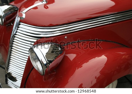 Vintage, shiny, red car. Classic luxury limousine. History of automobile.