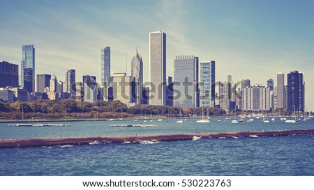 Vintage toned Chicago waterfront and city skyline on a sunny day, USA.