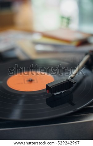 vintage turntable playing music in vintage color tone