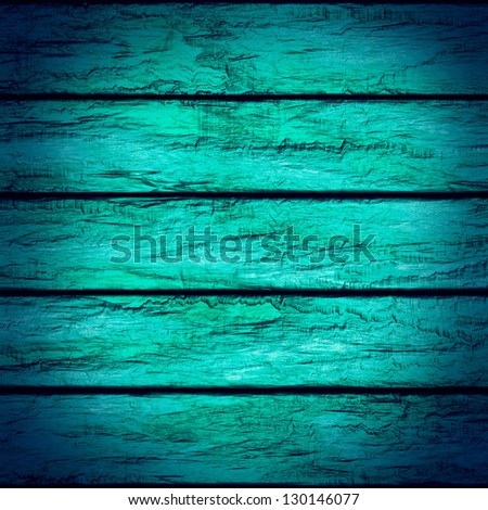 Vintage turquoise wood background with vignette