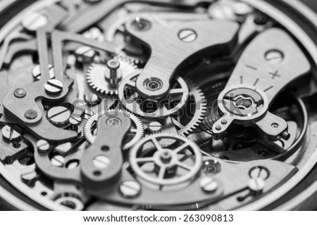 Vintage watch movement close-up. Showing cogs, wheels and jewels.