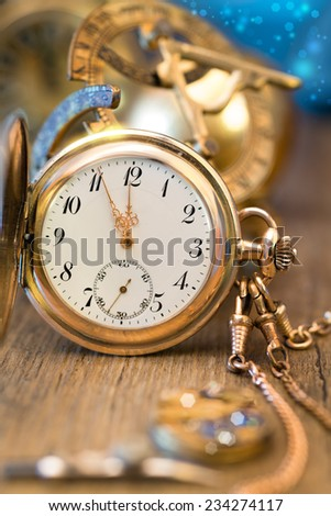 Vintage watch on a festive background showing five to twelve, Happy New Year!