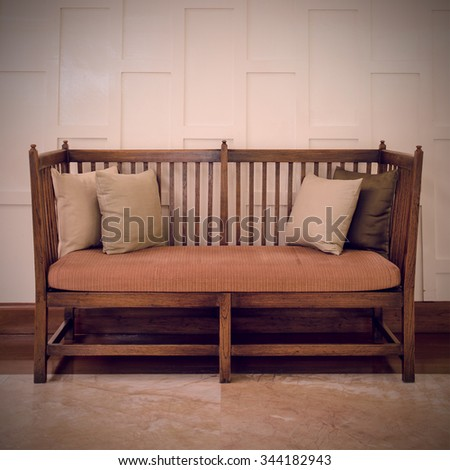 Vintage wooden chair with cushion and pillows